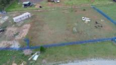 Aerial view of one portion divided by blue palisades and electric fencing