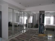 Main bedroom with full mirrored cupboards