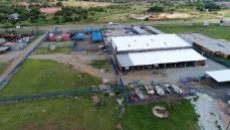 Aerial view of building from behind as well the adjacent properties for sale