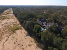 Riverbed and house from above