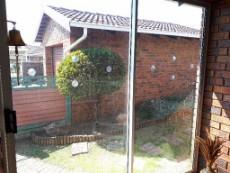 View of front garden and garage from sun room