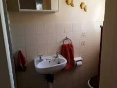 2nd bathroom with shower on left, wash basin and toilet
