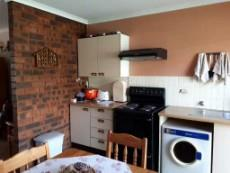 Kitchen with built-in cupboards and stove