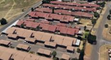 Aerial view of unit showing large parking area and garden