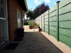 View of paved area at back of unit towards garden
