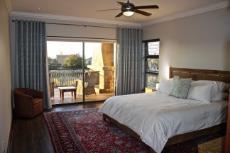 Guest bedroom with balcony and en-suite shower room
