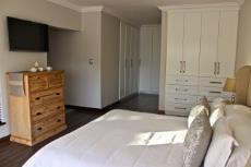 Main bedroom with built-in cupboards