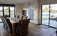 Entertainment area with sliding doors to garden and pool