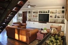Open-plan lounge with built-in wall unit