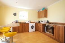 Kitchen in the separate flat meets all the requirements of a bachelor pad
