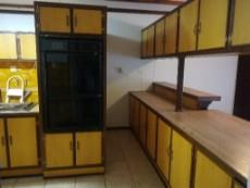 Kitchen with eye level oven.
