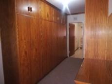 Ample cupboard space in main bedroom.