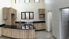 Kitchen with stainless steel gas stove and electrical oven