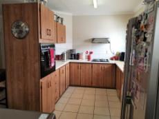 Kitchen with double eye level oven, hob & extractor
