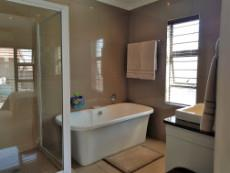 Full main-en-suite bathroom with double basins and private toilet