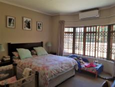 Large main bedroom with air conditioner and bay window