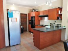 Open plan kitchen with double eye level oven, hob & extractor
