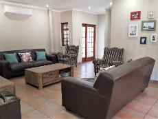 Lounge area with an anthracite stove and air conditioner