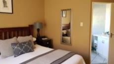 Sunny master bedroom with en-suite bathroom.