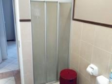 Bathroom with shower, bath, basin and toilet