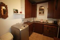 Laundry with point for washing machine and tumble dryer