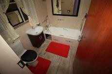 Main bedroom with bath, basin and toilet