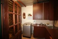 Laundry with built in cupboards