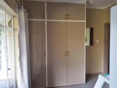 2nd Bedroom with built-in-cupboards and ceiling fan