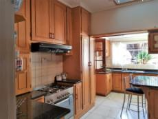 Lovely kitchen with granite tops and large gas stove