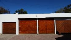 4 Garages with wooden doors closed
