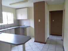 kitchen with space for washer and drier with fridge