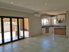 Open plan living areas and kitchen with stacker doors and air conditioning