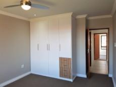 3rd Bedroom with built-in-cupboards and ceiling fan