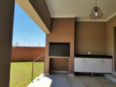 Braai room with lovely view over the garden and stacker doors into the living areas