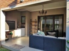 Under roof patio with built-in-braai that can be enclosed