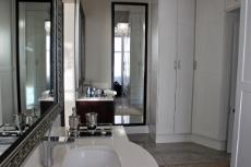 Main bathroom with double vanity and built-in wardrobe