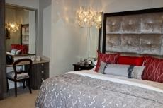 Guest bedroom with built-in cupboards and dressing table