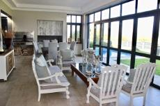 Entertainment area with folding doors to garden and pool
