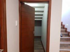 Store room under the staircase - ideal broom cupboard