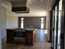Kitchen with Elba stove nestled into the island & extractor