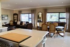 View from kitchen island into open-plan dining area and lounge
