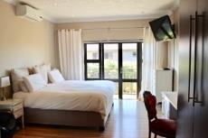 Main bedroom with view of landscape
