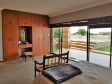 Main bedroom on ground floor with sliding doors to the pool