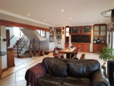 Lounge, dining area and built-in-braai