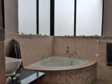 Main-en-suite with corner bath and large windows