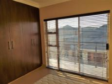 3rd Bedroom with built-in-cupboards and sliding doors to the balcony