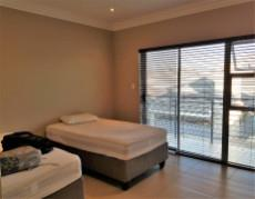 2nd Bedroom with built-in-cupboards and sliding doors to the balcony