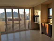 Braai room with stacker doors forming part of open plan living areas