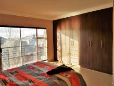 Main bedroom with sliding doors leading to the balcony