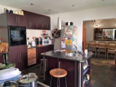 Kitchen with granite tops and island with eye level oven